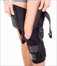 Orteză de genunchi mobilă cu articulaţii reglabile